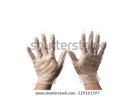 Close-up of a human hand with transparent surgical gloves. - stock photo