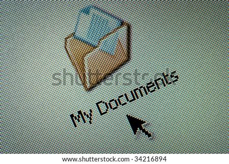 Close-up of a interface computer folder button and an arrow cursor - stock photo