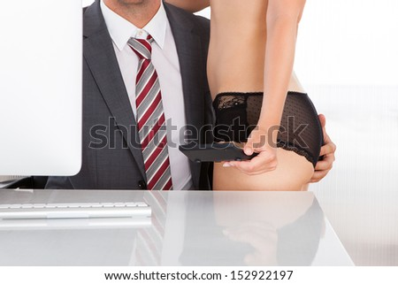 Close-up of a intimate couple in office - stock photo