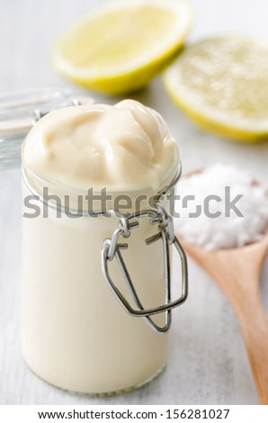 Close up of a jar of fresh homemade mayo as a condiment dressing for salads and sandwiches - stock photo