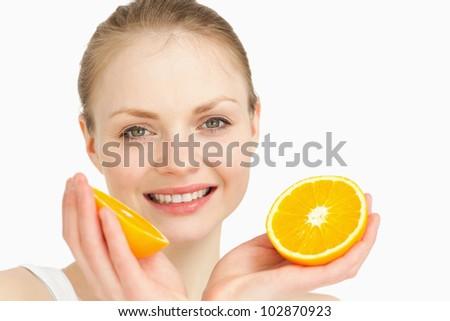 Close up of a joyful holding oranges against white background - stock photo