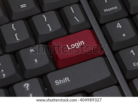 Close up of a keyboard with red enter button written LOGIN - stock photo