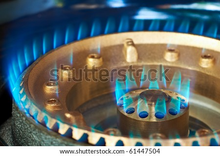 Close-up of a kitchen burner propan-butan blue flame - stock photo