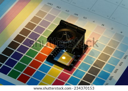 Close-up of a loupe on a test print - stock photo