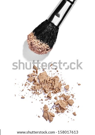 close up of  a make up powder and a brush on white background - stock photo