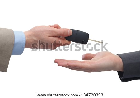 Close up of a male hand  taking car key - stock photo