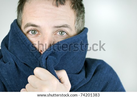 Close-up of a man bundled up in his housecoat. - stock photo