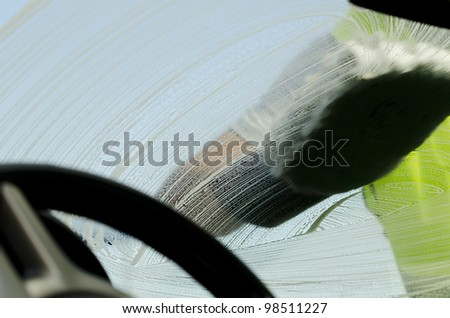 Close-up of a man cleaning a car with sponge - stock photo