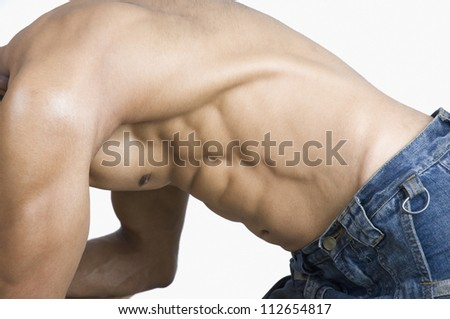 Close-up of a man flexing muscles - stock photo
