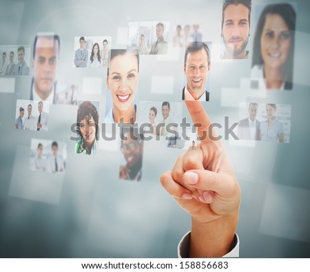 Close up of a man selecting a profile picture on digital screen - stock photo