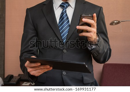 Close up of a man using mobile smart phone.  - stock photo