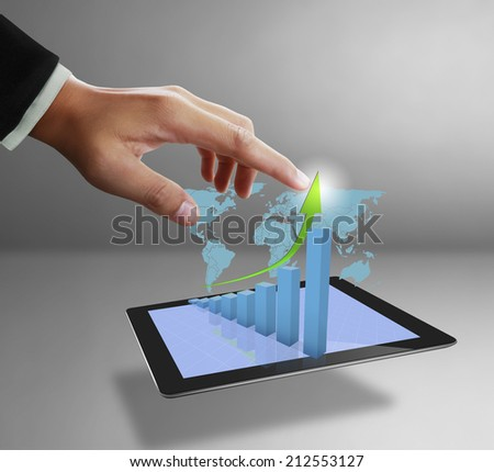 Close up of a man using tablet computer,show business graph - stock photo