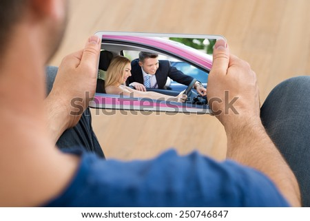 Close-up Of A Man Watching Video On Cellphone - stock photo