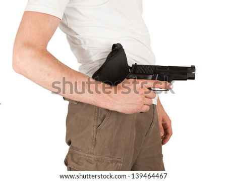 Close-up of a man with holster and a gun, isolated on white - stock photo