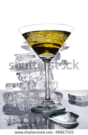 Close up of a martini glass against a pile of clear ice - stock photo