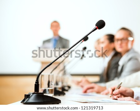 close-up of a microphone, a speaker at the conference - stock photo