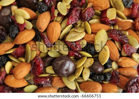 Close up of a mixed of nuts, dry fruits and chocolate - stock photo