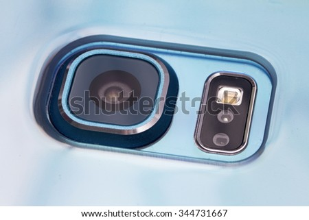 Close up of a mobile phone camera, flash and sensors. - stock photo