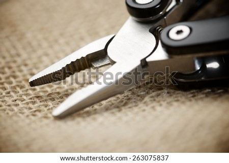 Close up of a multitool pliers. - stock photo