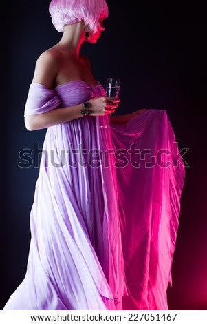 Close up of a mysterious girl in a ball dress spinning. - stock photo
