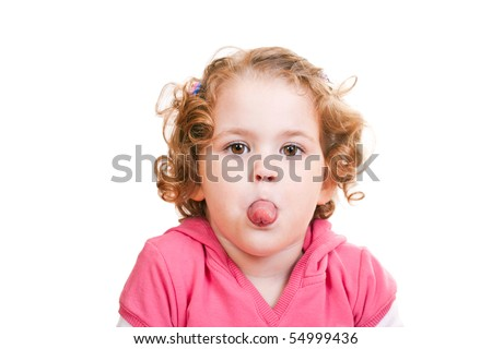 close-up of a naughty little girl sticking out tongue - stock photo