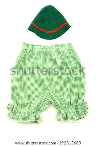 Close up of a newborn baby green hat and infant pants with stripes isolated - stock photo