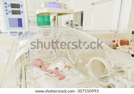 "Close-up of a newborn innocent baby sleeping in an incubator in the Obstetrics and Gynecology Hospital ""Maichin dom"" in Sofia, Bulgaria, March 18, 2015 - stock photo"