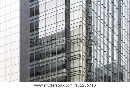 Close up of a office building made of glass - stock photo