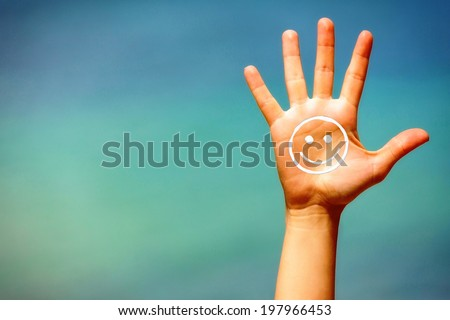 Close up of a open hand, with suncream on it, on blue background. - stock photo