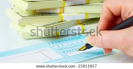 Close up of a pen and blank check. - stock photo