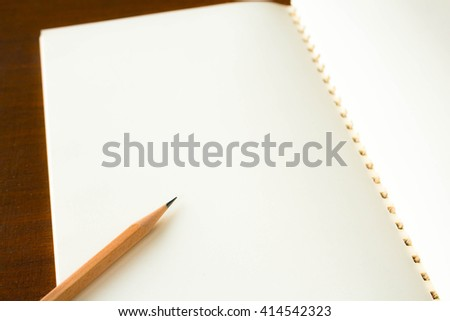 Close up of a pencil and a notebook - stock photo