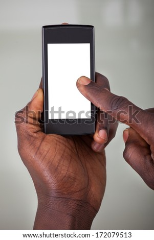 Close-up Of A Person Holding Cellphone With Blank Screen - stock photo