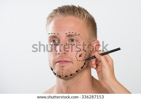 Close-up Of A Person's Hand Drawing Correction Line With Pen - stock photo