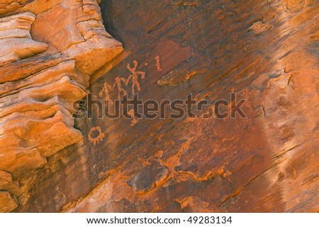 Close-up of a petroglyph of human figures etched on rock wall, Valley of Fire State Park, Nevada, USA - stock photo