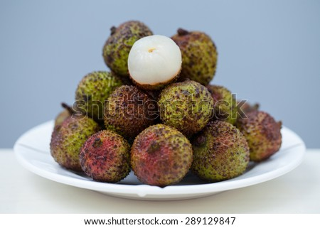 Close up of a pile lychee in plate . - stock photo