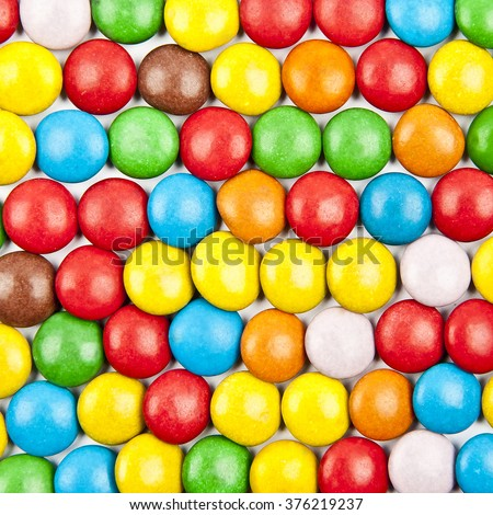 Close up of a pile of colorful chocolate coated candy in a row - stock photo