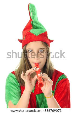 Close-up of a pretty teen Christmas elf playing a red recorder.  On a white background. - stock photo