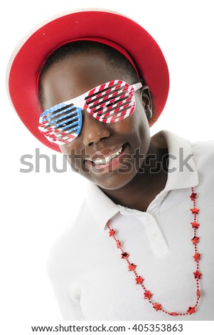 Close-up of a pretty tween girl dressed to celebrate America with red, white and blue louvered sun glasses.  On a white background. - stock photo