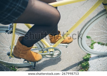 Close up of a pretty woman on bicycle in the park - stock photo