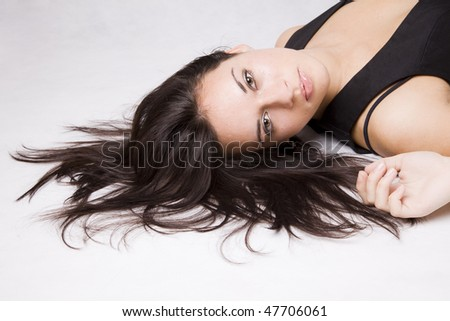 close up of a pretty young girl lying on the floor - stock photo