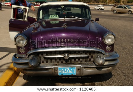 Close-up of a purple colored taxi cab, Havana, Cuba - stock photo