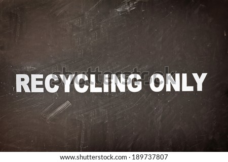 Close up of a recycling only sign on a recycling bin with nicks and scratches.  - stock photo