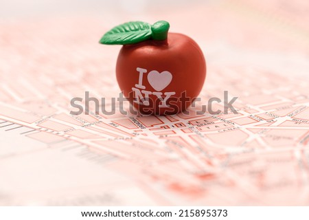 """Close-up of a red apple with 'I love NY"""" text on a map of NY city. I 'love New York' concept.  - stock photo"""