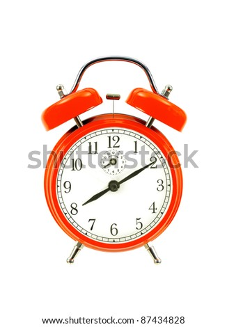 close up of a red bell clock (alarm clock) isolated on white background - stock photo
