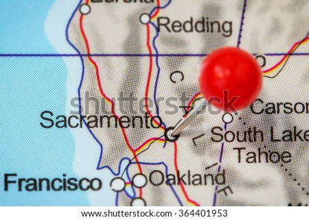 Close-up of a red pushpin in a map of Sacramento, USA. - stock photo