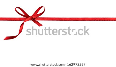 close up of a  red ribbon bow on white background - stock photo