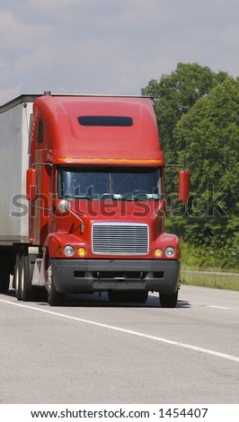Close up of a Red Semi Truck - stock photo