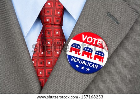 Close up of a republican voting badge on the suit jacket lapel of an American voter. - stock photo