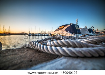 close up of a rope in Alghero harbor, Sardinia - stock photo
