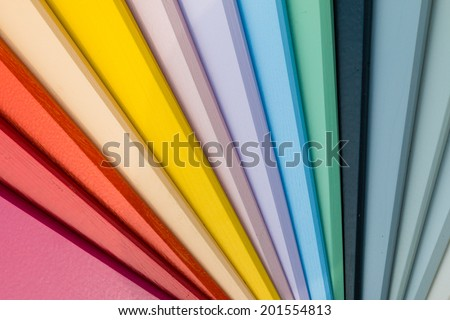 Close up of a sample of wood colors arranged in a palette for decision making in interior and exterior design - stock photo